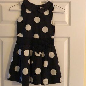 Holiday black dress with white polka dots